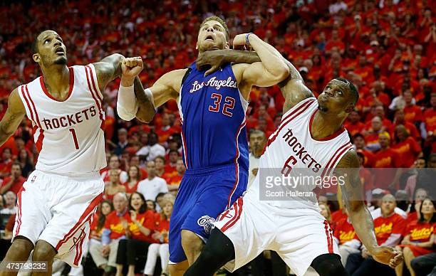 Blake Griffin of the Los Angeles Clippers vies for position with Terrence Jones and Trevor Ariza of the Houston Rockets in the fourth quarter during...