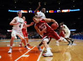 Blake Griffin of the Oklahoma Sooners drives to the basket against the Purdue Boilermakers during the Championship game of the PreSeason NIT...
