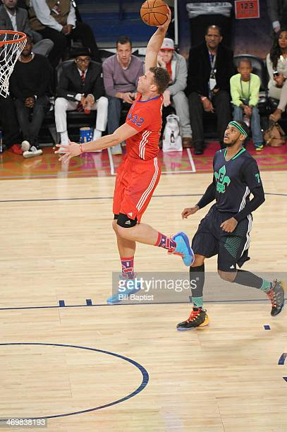 Blake Griffin of the Western Conference AllStars dunks against Carmelo Anthony of the Eastern Conference AllStars during the 2014 NBA AllStar Game at...