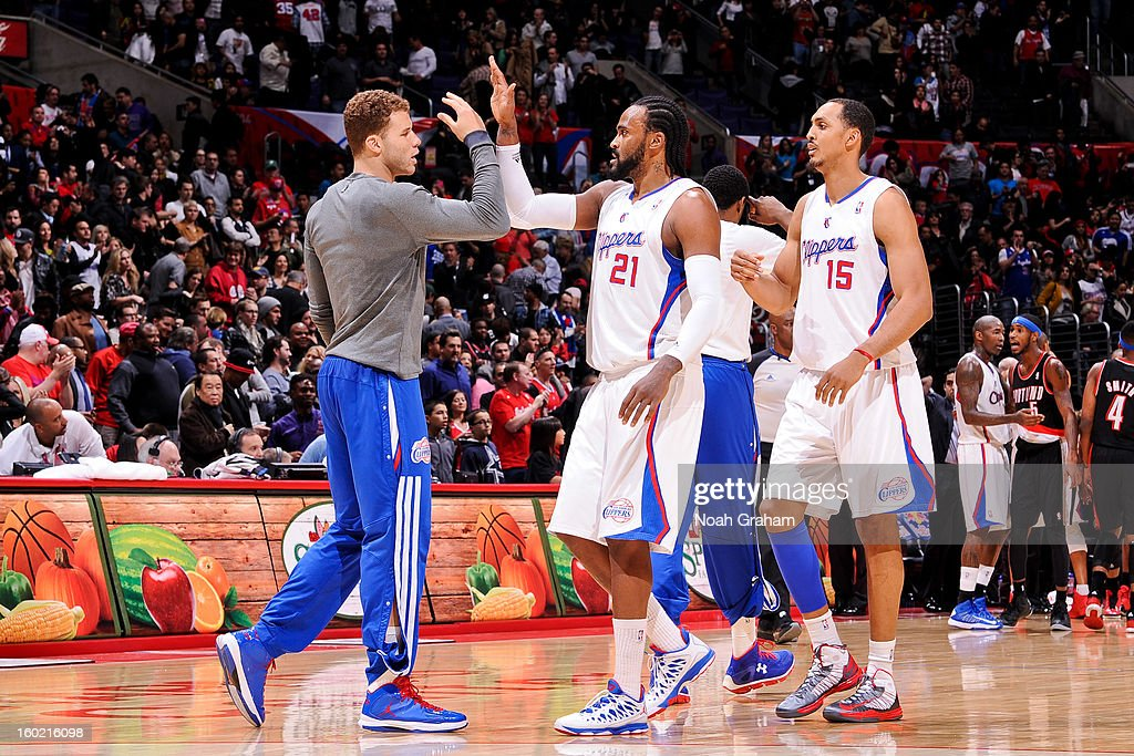 Blake Griffin #32, Ronny Turiaf #21, and Ryan Hollins #15 of the Los Angeles Clippers celebrate during a game against the Portland Trail Blazers at Staples Center on January 27, 2013 in Los Angeles, California.