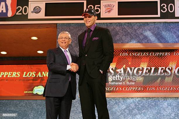 Blake Griffin shakes hands with NBA Commissioner David Stern after being selected first by the Los Angeles Clippers during the 2009 NBA Draft on June...