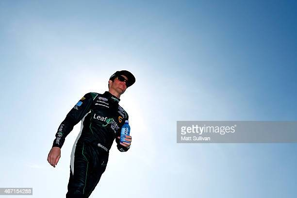Blake Koch driver of the AQUAhydrate Toyota walks on the grid prior to qualifying for the NASCAR XFINITY Series Drive4Clotscom 300 at Auto Club...