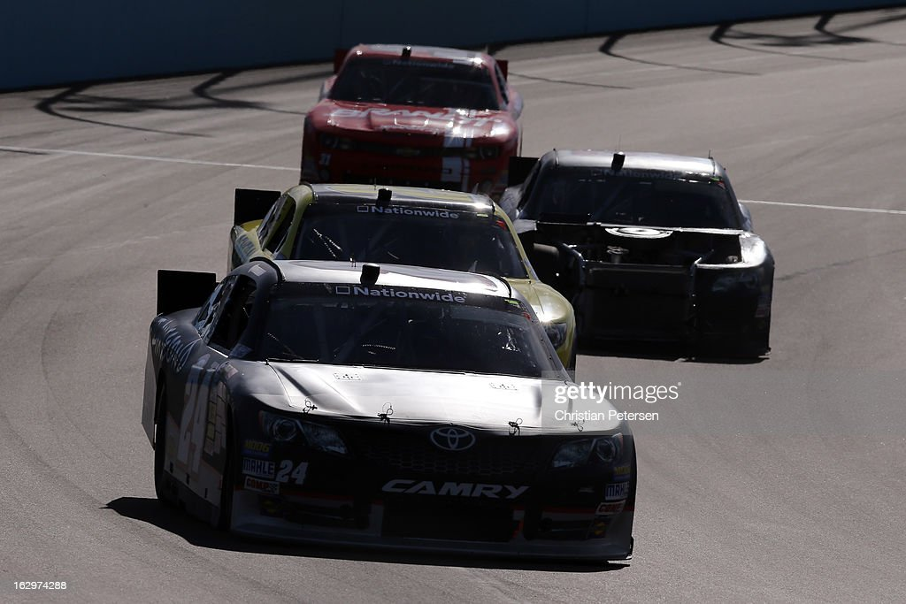 Blake Koch, driver of the #24 I Am Second/Salt Life Toyota, drives ahead of a group of cars during the NASCAR Nationwide Series Dollar General 200 fueled by AmeriGas at Phoenix International Raceway on March 2, 2013 in Avondale, Arizona.