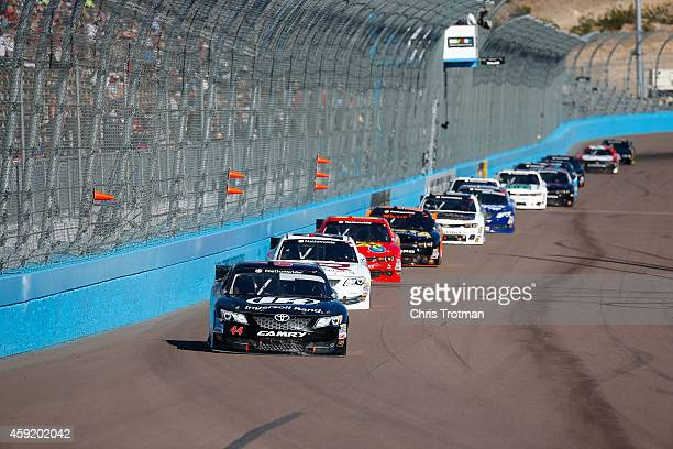 Blake Koch driver of the Ingersoll Rand Toyota leads a pack of cars during the NASCAR Nationwide Series DAV 200 at Phoenix International Raceway on...