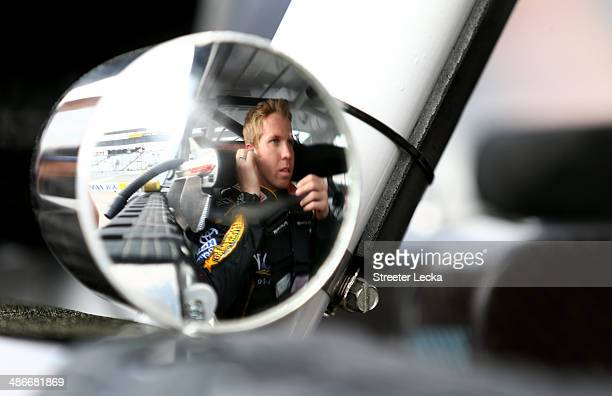 Blake Koch driver of the KLOVE Crisis Response Training Toyota sits in his car during qualifying for the NASCAR Nationwide Series ToyotaCare 250 at...