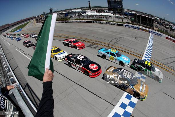 Blake Koch driver of the LeafFilter Gutter Protection Chevrolet and Kasey Kahne driver of the Armour Chevrolet lead the field past the green flag to...
