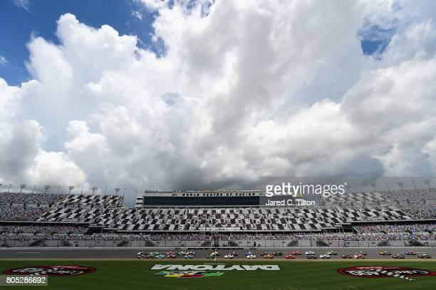 Blake Koch driver of the LeafFilter Gutter Protection Chevrolet and Ben Kennedy driver of the Rheem Chevrolet lead the field past the green flag to...