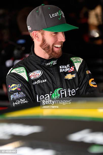 Blake Koch driver of the LeafFilter Gutter Protection Chevrolet stands in the garage area during practice for the NASCAR XFINITY Series Kansas...