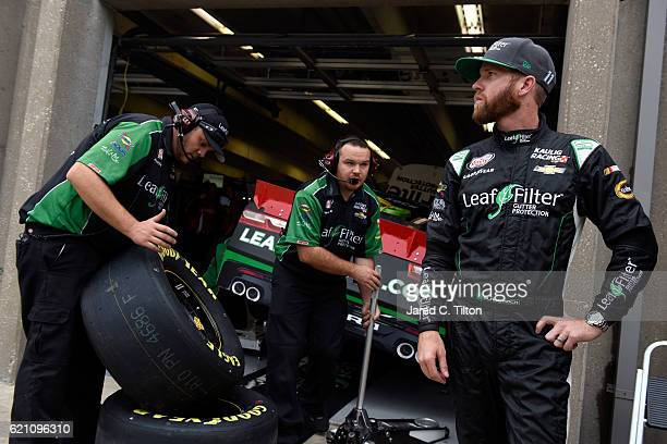 Blake Koch driver of the LeafFilter Gutter Protection Chevrolet stands in the garage area during practice for the NASCAR XFINITY Series O'Reilly Auto...