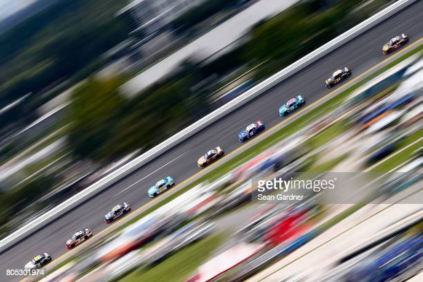 Blake Koch driver of the LeafFilter Gutter Protection Chevrolet leads a pack of cars during the NASCAR XFINITY Series CocaCola Firecracker 250 at...