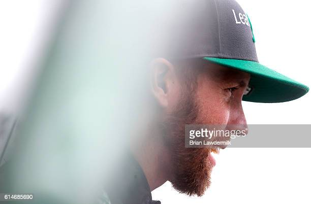 Blake Koch driver of the LeafFilter Gutter Protection Chevrolet looks on during practice for the NASCAR XFINITY Series Kansas Lottery 300 at Kansas...