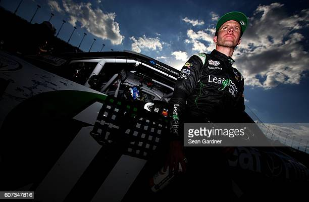 Blake Koch driver of the LeafFilter Gutter Protection Chevrolet stands on the grid following the NASCAR XFINITY Series Drive for Safety 300 at...