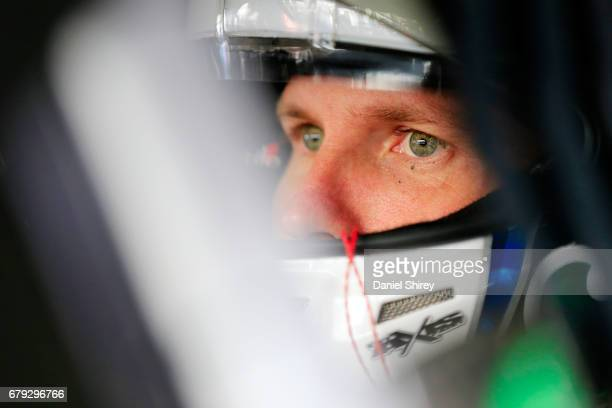 Blake Koch driver of the LeafFilter Gutter Protection Chevrolet sits in his car during practice for the NASCAR XFINITY Series Sparks Energy 300 at...
