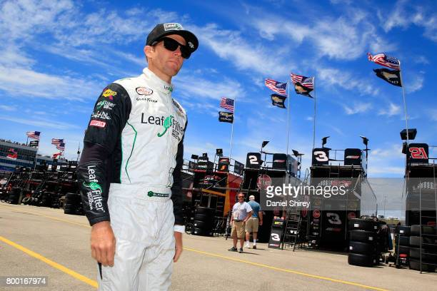 Blake Koch driver of the LeafFilter Gutter Protection Chevrolet walks through the garage area during practice for the NASCAR XFINITY Series American...