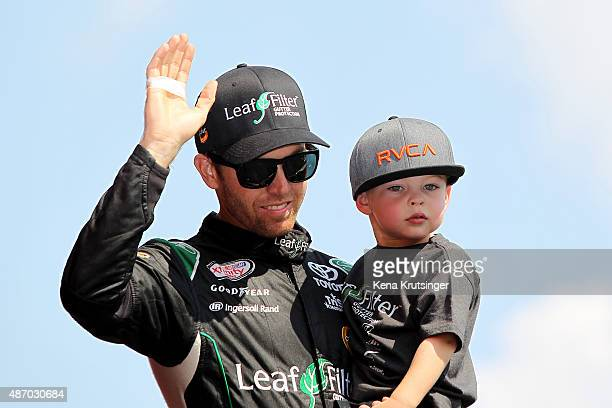 Blake Koch driver of the LeafFilter Gutter Protection Toyota takes part in prerace ceremonies for the NASCAR XFINITY Series VFW Sport Clips Help A...