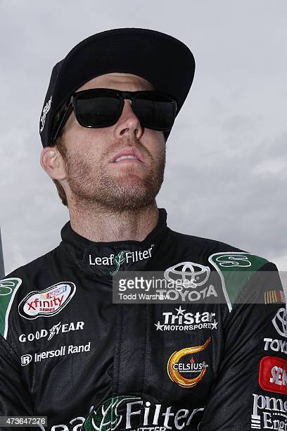Blake Koch driver of the Toyota stands on the grid during qualifying for the NASCAR Xfinity Series 3M 250 at Iowa Speedway on May 16 2015 in Newton...