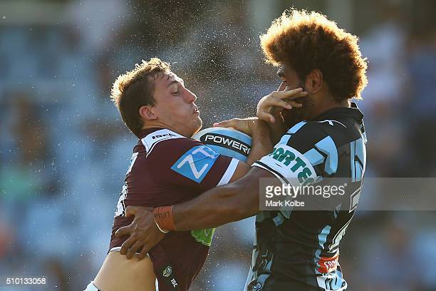 Blake Leary of the Eagles is tackled by Junior Roqica of the Sharks during the NRL Trial match between the Cronulla Sharks and the Manly Sea Eagles...