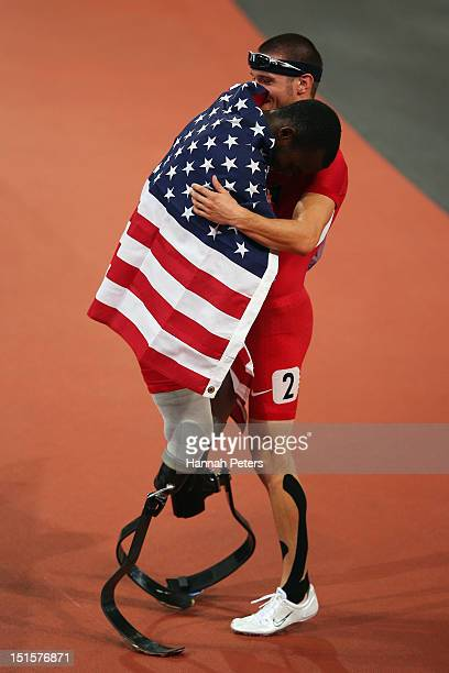 Blake Leeper of the United States celebrates with Jarryd Wallace of the United States after winning silver in the Men's 400m T44 Final on day 10 of...