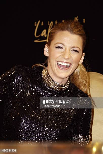 Blake Lively attends a photocall and meets 'Gucci Premiere' competition winners at Galeries Lafayette Dubai Mall on January 3 2014 in Dubai United...