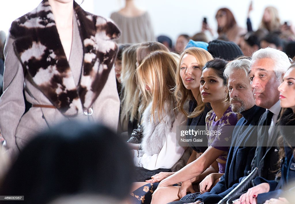 <a gi-track='captionPersonalityLinkClicked' href=/galleries/search?phrase=Blake+Lively&family=editorial&specificpeople=221673 ng-click='$event.stopPropagation()'>Blake Lively</a>, <a gi-track='captionPersonalityLinkClicked' href=/galleries/search?phrase=Freida+Pinto&family=editorial&specificpeople=5518973 ng-click='$event.stopPropagation()'>Freida Pinto</a> and <a gi-track='captionPersonalityLinkClicked' href=/galleries/search?phrase=Michael+Douglas&family=editorial&specificpeople=171111 ng-click='$event.stopPropagation()'>Michael Douglas</a> attend the Michael Kors Show during Mercedes-Benz Fashion Week Fall 2014 at Spring Studios on February 12, 2014 in New York City.
