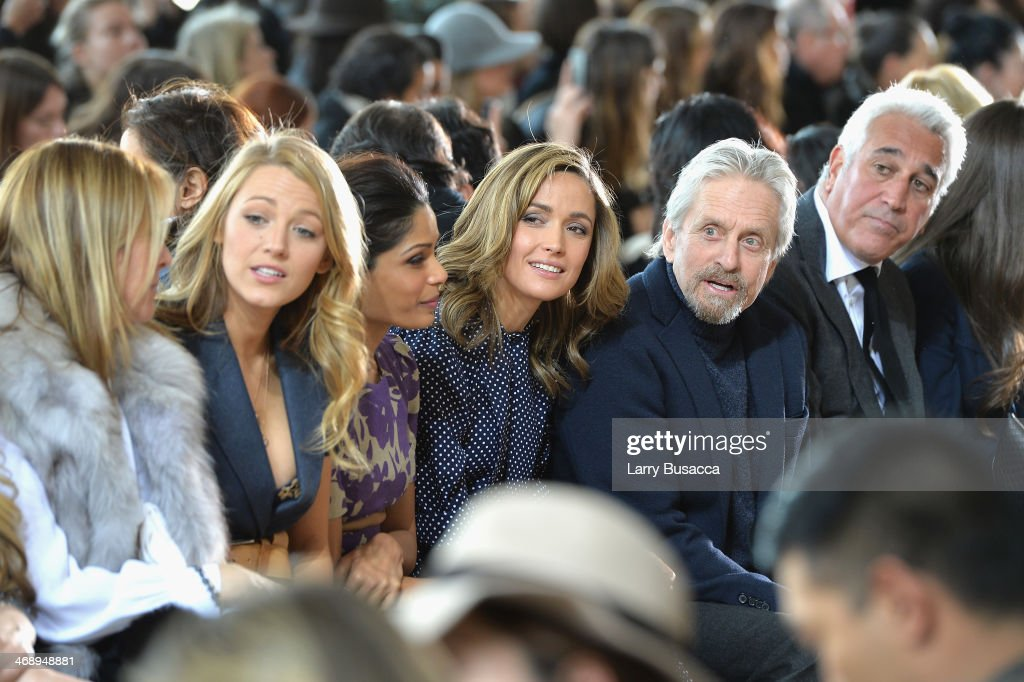 <a gi-track='captionPersonalityLinkClicked' href=/galleries/search?phrase=Blake+Lively&family=editorial&specificpeople=221673 ng-click='$event.stopPropagation()'>Blake Lively</a>, <a gi-track='captionPersonalityLinkClicked' href=/galleries/search?phrase=Freida+Pinto&family=editorial&specificpeople=5518973 ng-click='$event.stopPropagation()'>Freida Pinto</a>, Rose Bryne and <a gi-track='captionPersonalityLinkClicked' href=/galleries/search?phrase=Michael+Douglas&family=editorial&specificpeople=171111 ng-click='$event.stopPropagation()'>Michael Douglas</a> attend the Michael Kors fashion show during Mercedes-Benz Fashion Week Fall 2014 at Spring Studios on February 12, 2014 in New York City.