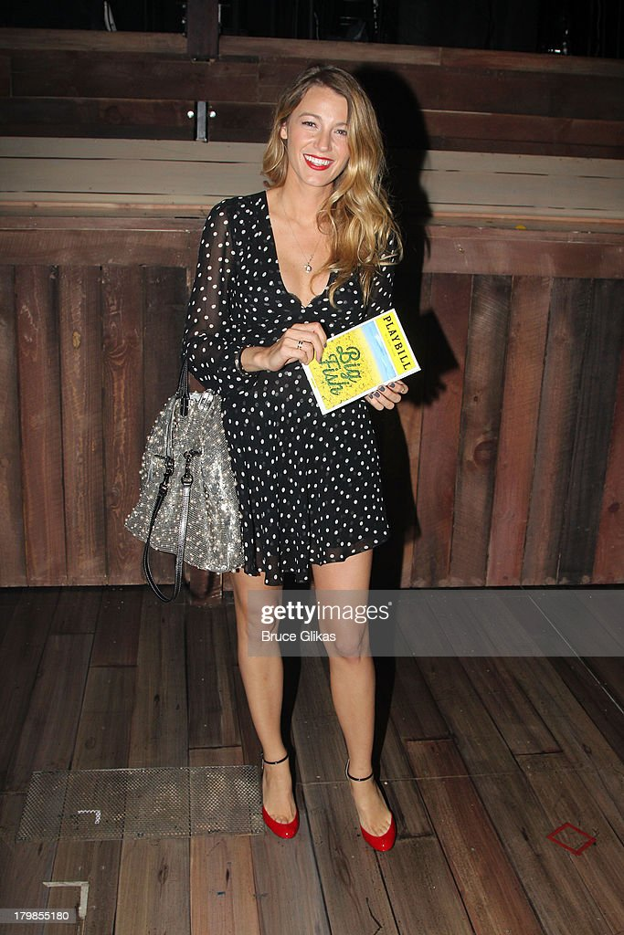 Blake Lively poses backstage (as she and husband Ryan Reynolds celebrate their 1st wedding anniversary) at the musical 'Big Fish' on Broadway at The Neil Simon Theater on September 6, 2013 in New York City.