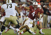 Blake Martinez of the Stanford Cardinal gets tackled after intercepting a pass against the UCF Knights in the third quarter at Stanford Stadium on...