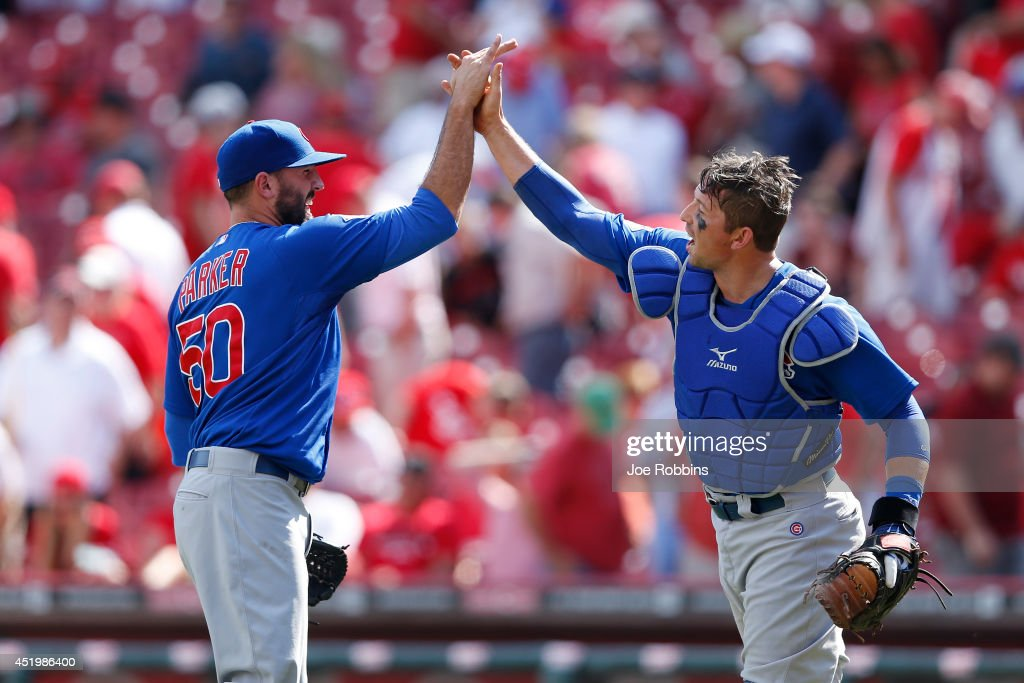 Blake Parker #50 and John Baker #12 of the Chicago Cubs celebrate after the final out of the game against the Cincinnati Reds at Great American Ball Park on July 10, 2014 in Cincinnati, Ohio. The Cubs won 6-4 in 12 innings.