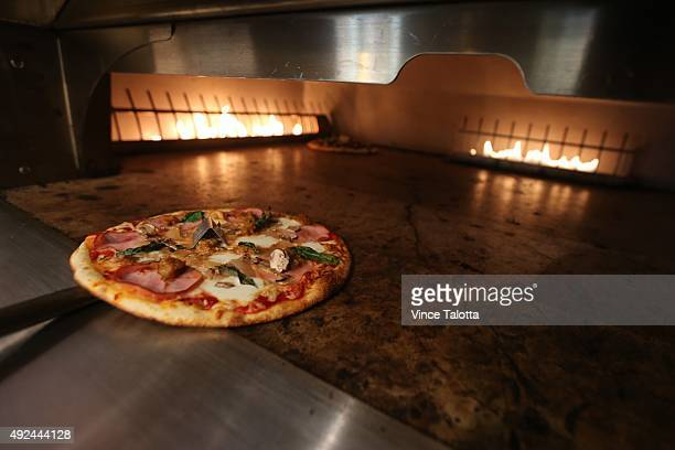 Blake Pizza comes out of the oven which took 180 seconds to cook at Blaze Pizza on Dundas St E at Yonge St in Toronto