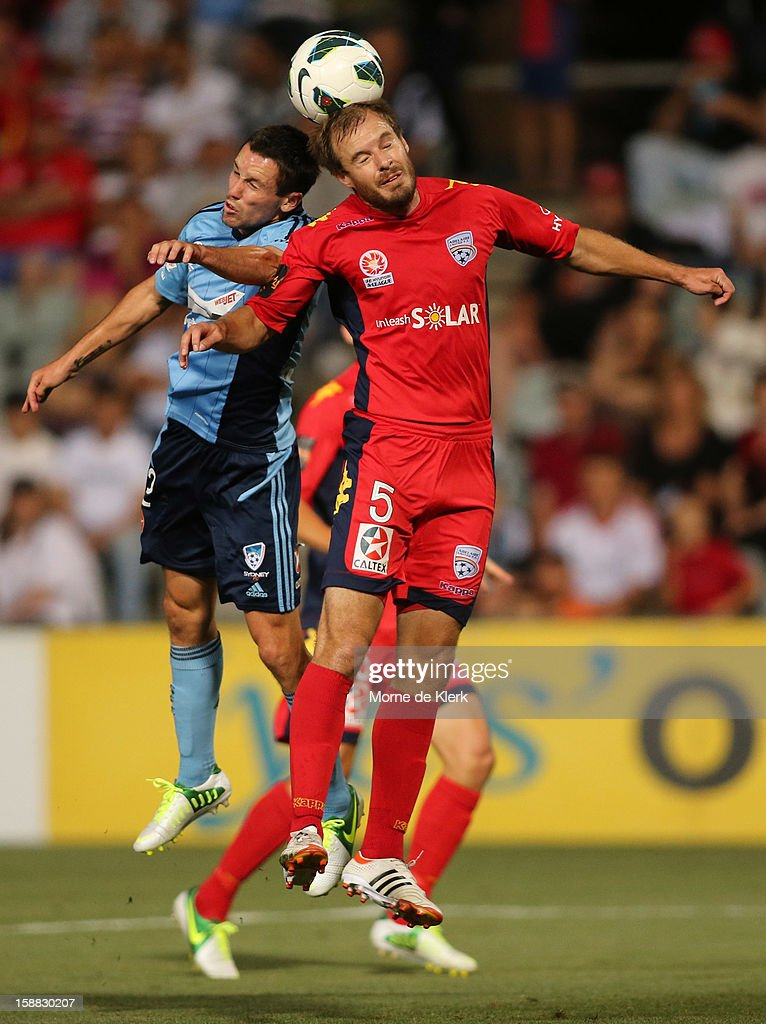 Blake Powell of Sydney competes in the air with Iain Fyfe of Adelaide during the round 14 A-League match between Adelaide United and Sydney FC at Hindmarsh Stadium on December 31, 2012 in Adelaide, Australia.