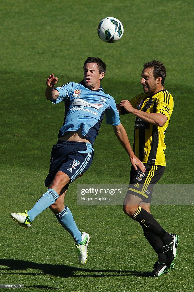 Blake Powell of Sydney FC and Andrew Durante of the Phoenix compete for a header during the round 10 A-League match between Wellington Phoenix and Sydney FC at Westpac Stadium on December 9, 2012 in Wellington, New Zealand.