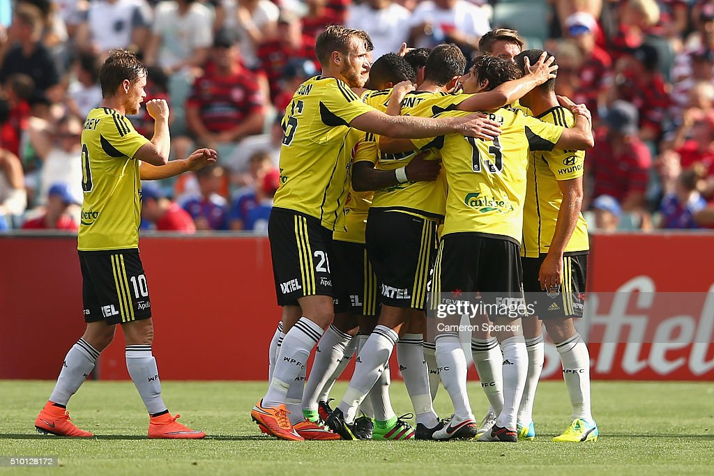 Blake Powell of the Phoenix celebrates with team mates after scoring a third goal during the round 19 A-League match between the Western Sydney Wanderers and the Wellington Phoenix at Pirtek Stadium on February 14, 2016 in Sydney, Australia.