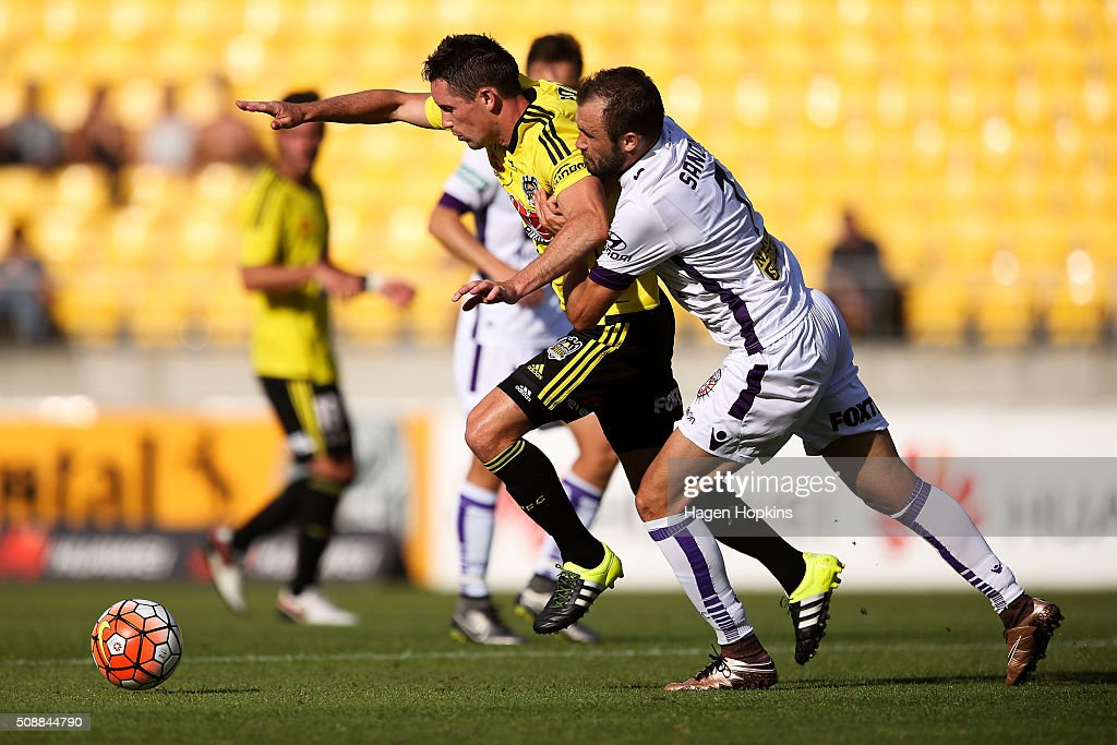 Blake Powell of the Phoenix is challenged by Gyorgy Sandor of the Glory during the round 18 A-League match between Wellington Phoenix and Perth Glory at Westpac Stadium on February 7, 2016 in Wellington, New Zealand.