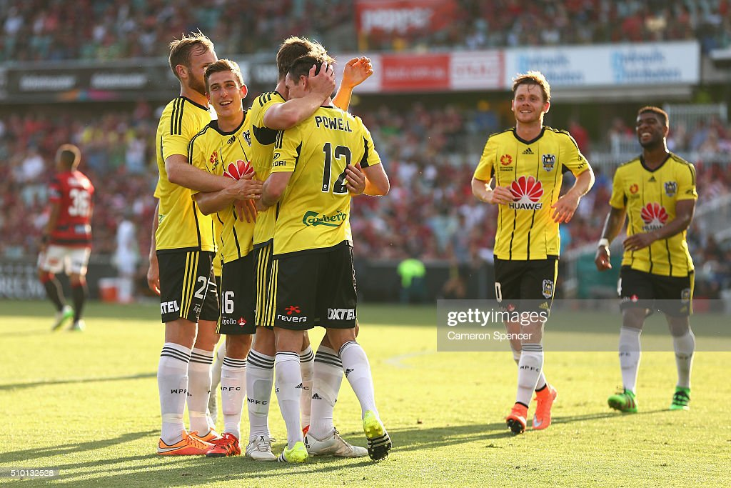 Blake Powell of the Phoenix is congratulated by team mates after scoring a goal during the round 19 A-League match between the Western Sydney Wanderers and the Wellington Phoenix at Pirtek Stadium on February 14, 2016 in Sydney, Australia.