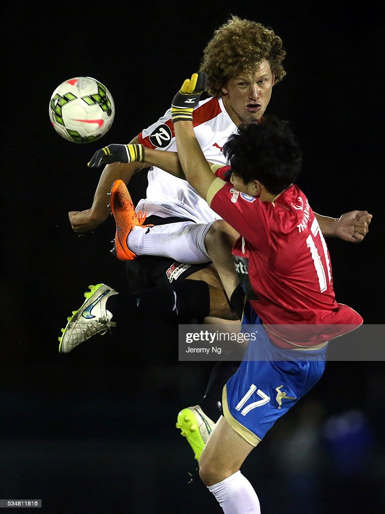 Blake Ricciuto of the Suns and Mun-soo Gil of the White Eagles contest for the ball during the men's National Premier League match between Bonnrigg and Rockdale at Bonnyrigg Sports Club on May 28, 2016 in Sydney, Australia.
