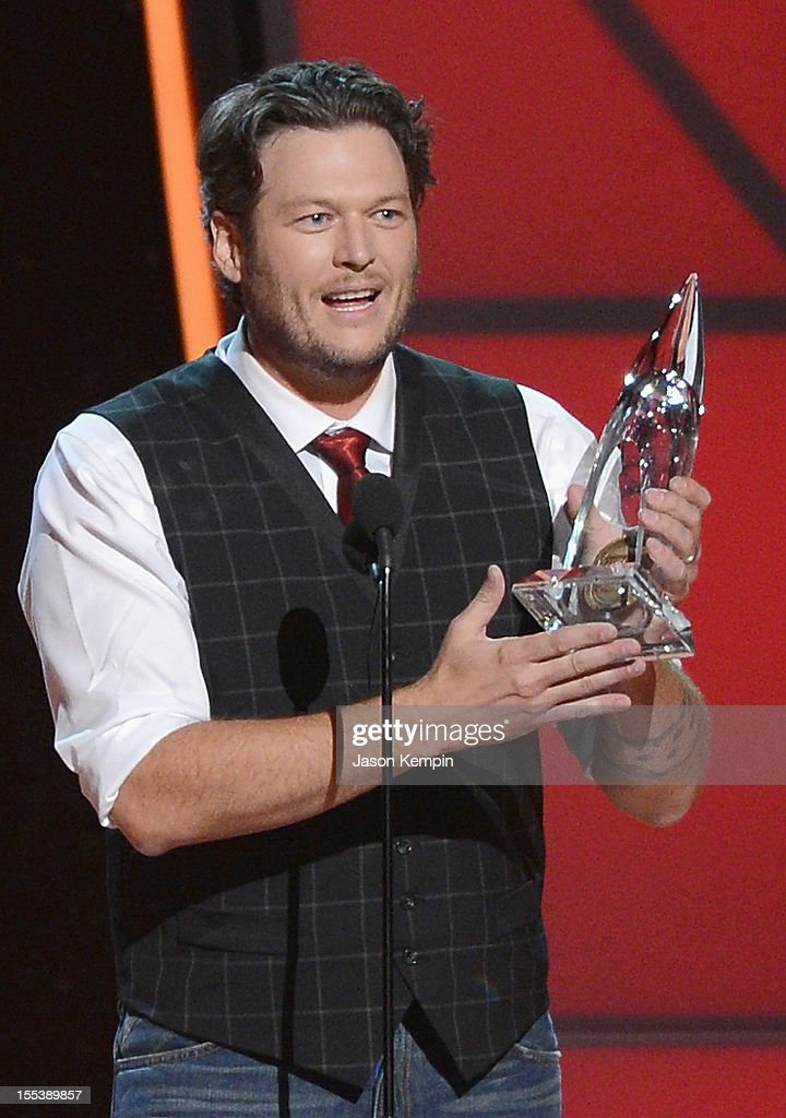 Blake Shelton accept award onstage for Entertainer of the Year during the 46th annual CMA Awards at the Bridgestone Arena on November 1, 2012 in Nashville, Tennessee.