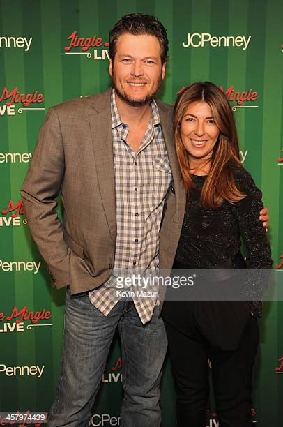 Blake Shelton and Nina Garcia attend a surprise holiday event and performance by Blake Shelton with the USO Show Troupe virtual carolers and...