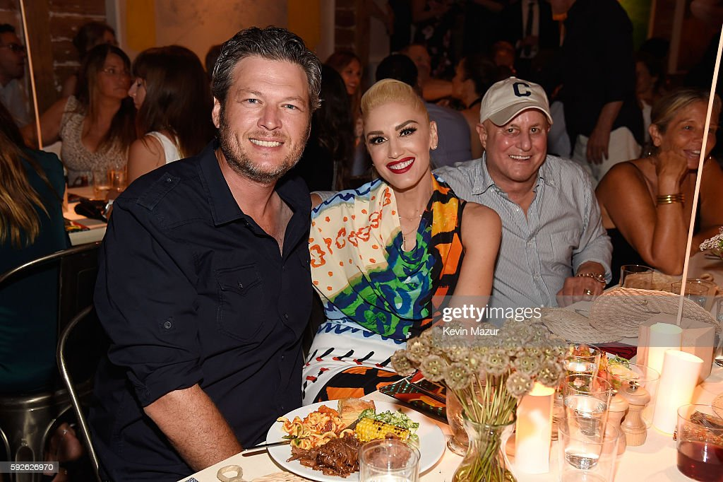 Blake Shelton Gwen Stefani and Ronald O Perelman attend Apollo in the Hamptons 2016 at The Creeks on August 20 2016 in East Hampton New York