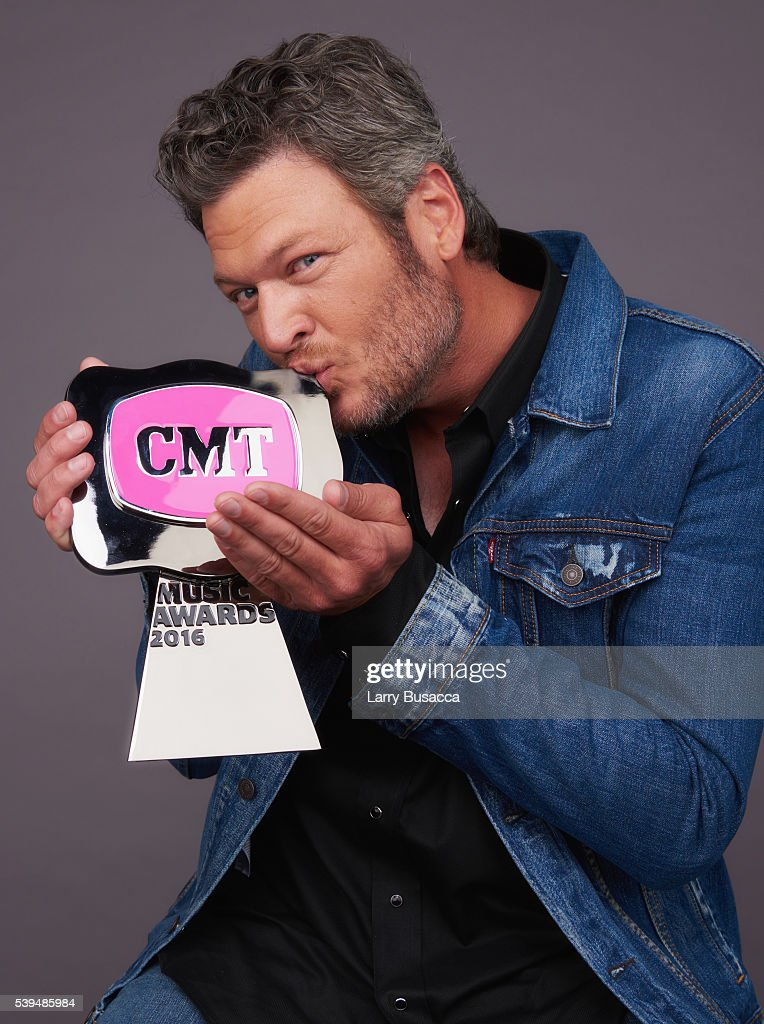 Blake Shelton poses with CMT Award for CMT Social Superstar in the 2016 CMT Music Awards portrait studio at Bridgestone Arena on June 8 2016 in...