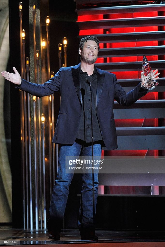 Blake Shelton receives the Male Vocalist of the Year award during the 47th annual CMA awards at the Bridgestone Arena on November 6, 2013 in Nashville, Tennessee.