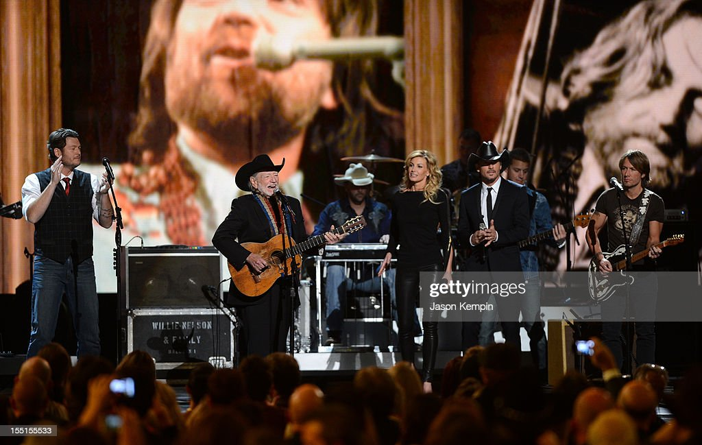<a gi-track='captionPersonalityLinkClicked' href=/galleries/search?phrase=Blake+Shelton&family=editorial&specificpeople=2352026 ng-click='$event.stopPropagation()'>Blake Shelton</a>, <a gi-track='captionPersonalityLinkClicked' href=/galleries/search?phrase=Willie+Nelson&family=editorial&specificpeople=203154 ng-click='$event.stopPropagation()'>Willie Nelson</a>, <a gi-track='captionPersonalityLinkClicked' href=/galleries/search?phrase=Faith+Hill&family=editorial&specificpeople=175933 ng-click='$event.stopPropagation()'>Faith Hill</a>, <a gi-track='captionPersonalityLinkClicked' href=/galleries/search?phrase=Tim+McGraw&family=editorial&specificpeople=202845 ng-click='$event.stopPropagation()'>Tim McGraw</a> and <a gi-track='captionPersonalityLinkClicked' href=/galleries/search?phrase=Keith+Urban&family=editorial&specificpeople=202997 ng-click='$event.stopPropagation()'>Keith Urban</a> perform during the 46th annual CMA Awards at the Bridgestone Arena on November 1, 2012 in Nashville, Tennessee.