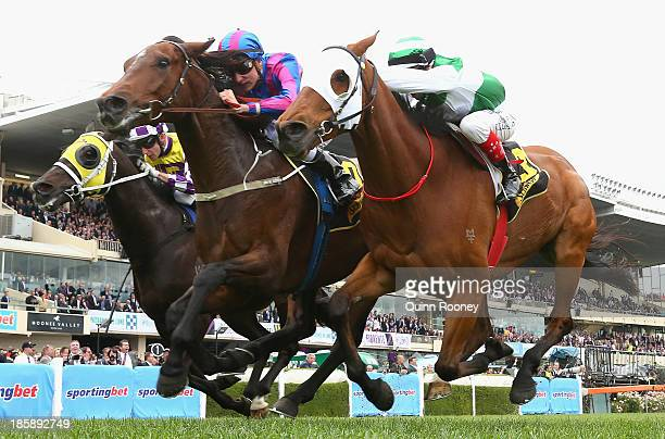 Blake Shinn riding Toydini crosses the line to win the Schweppes Crystal Mile just infront of Craig Williams riding Speediness during Cox Plate Day...