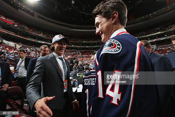 Blake Siebenaler meets pick#16 Sonnya Milano after being drafted by the Columbus Blue Jackets on Day Two of the 2014 NHL Draft at the Wells Fargo...