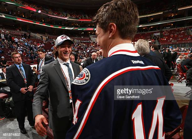 Blake Siebenaler selected 77th overall by the Columbus Blue Jackets is congratulated by 16th pick Sonny Milano during the 2014 NHL Entry Draft at...