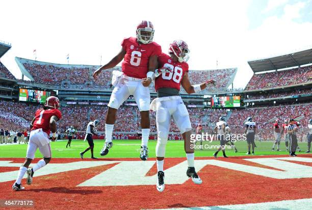 Blake Sims of the Alabama Crimson Tide is congratulated by O J Howard after scoring a first quarter touchdown against the Florida Atlantc Owls at...