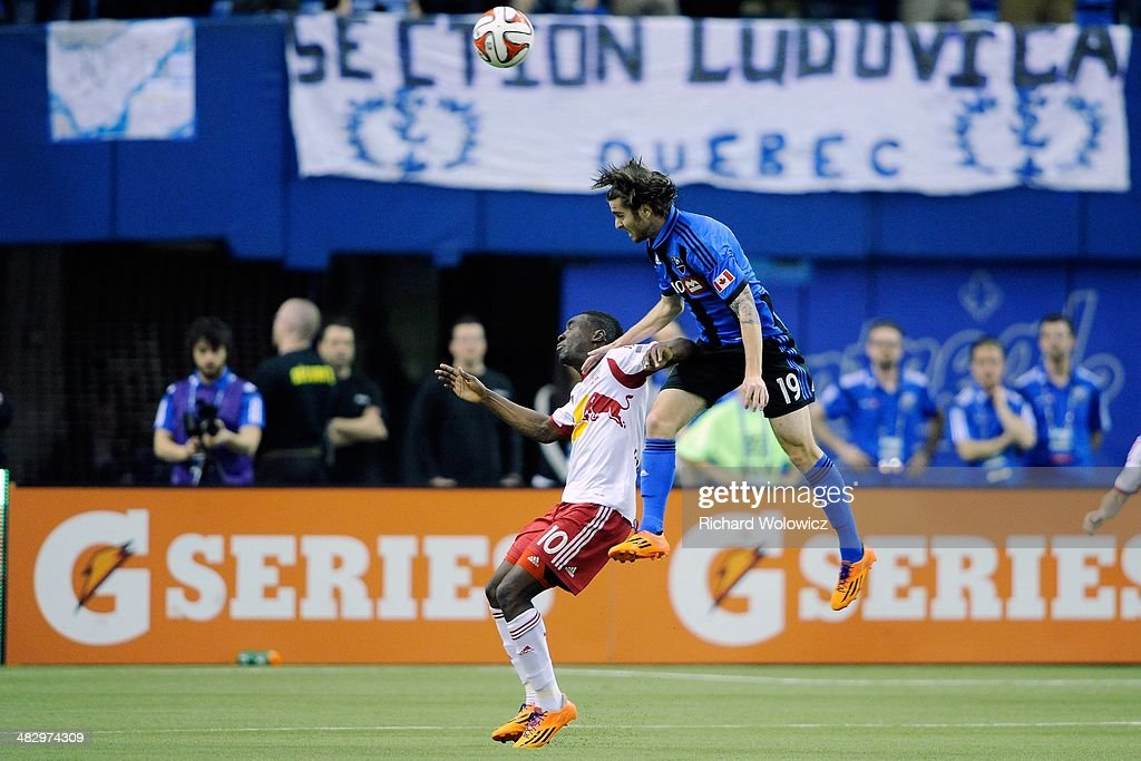 Blake Smith #19 of the Montreal Impact heads the ball in front of Lloyd Sam #10 of the New York RedBulls during the MLS game at the Olympic Stadium on April 5, 2014 in Montreal, Quebec, Canada.