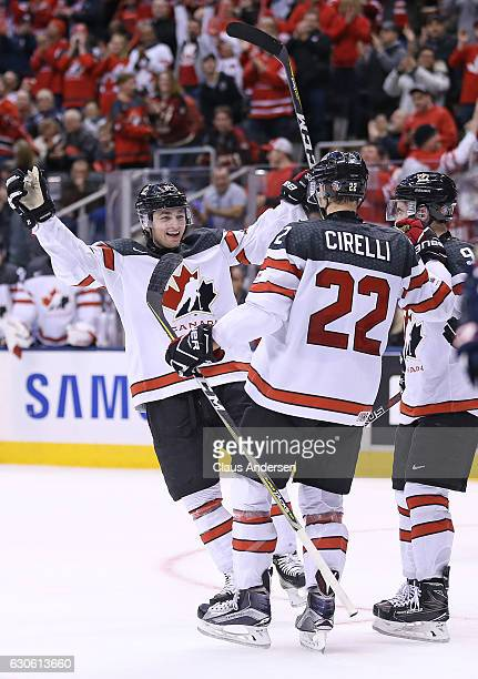 Blake Speers of Team Canada congratulates teammate Anthony Cirelli on his goal against Team Slovakia during a preliminary game in the 2017 IIHF World...