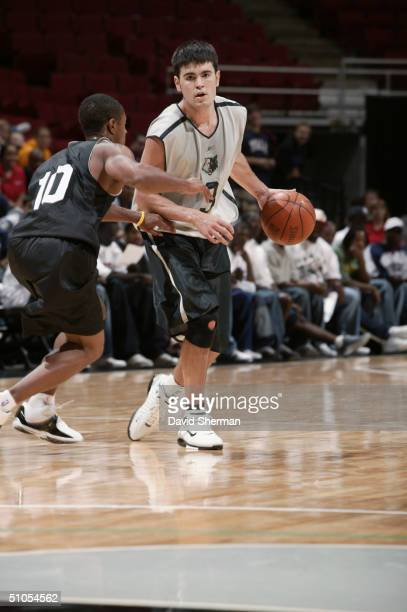Blake Stepp of the Minnesota Timberwolves is defended by Patrick Jackson of the Charlotte Bobcats during the 2004 Summer League game at Target Center...