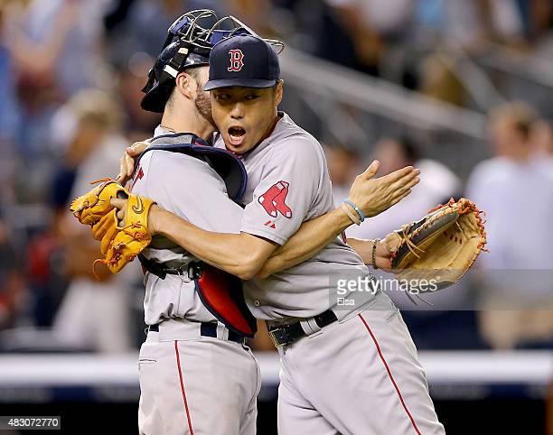 Blake Swihart and Koji Uehara of the Boston Red Sox celebrate the win over the New York Yankees on August 5 2015 at Yankee Stadium in the Bronx...