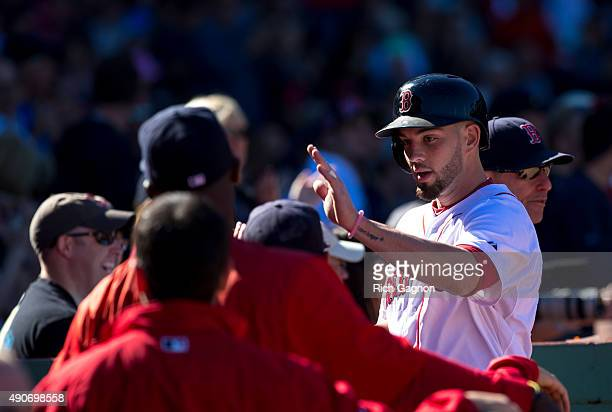 Blake Swihart of the Boston Red Sox celebrates with his teammates after he hit a home run during the third inning against the Baltimore Orioles at...